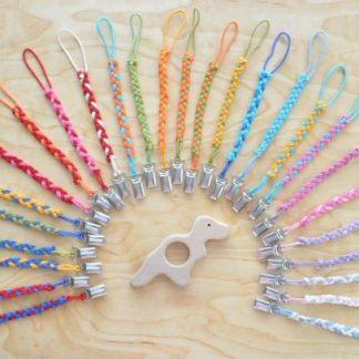 Select pacifier clip color for a baby T Rex dinosaur teether on BarinToys.com.