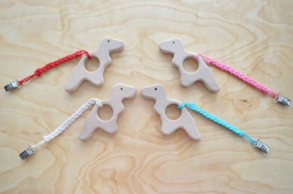 Buy T Rex Dinosaur Teether Toy for infant with pacifier clip on BarinToys.com. Choose the color of the strap braid.
