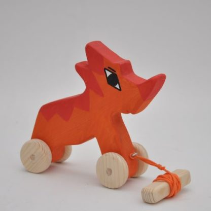 Buy Triceratops dinosaur wooden pull toy at BarinToys.com.