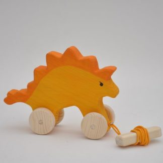 Buy coolest looking dinosaurs wooden toys at BarinToys.com online store! The best pull along Stego Dino wooden toy.